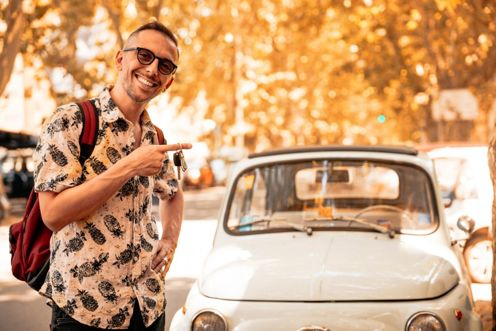 Happy Men With His Italian Vintage Car Showing Key