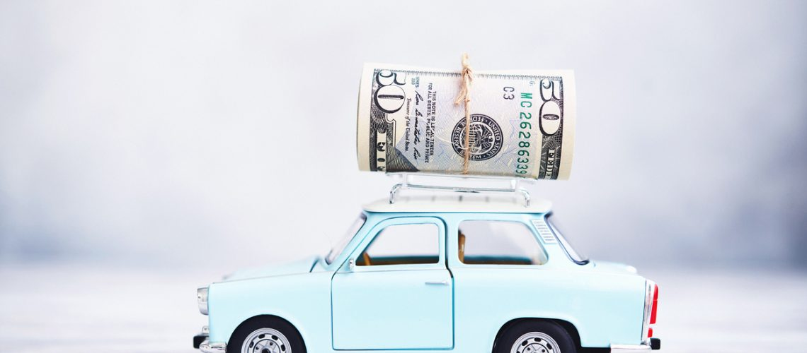 Little blue car with cash roll on roof rack